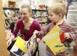 Photos from the 2015 World's Greatest Book GiveAway.  Photos by Tiffany Rushing:  Waterloo-Cedar Falls Courier